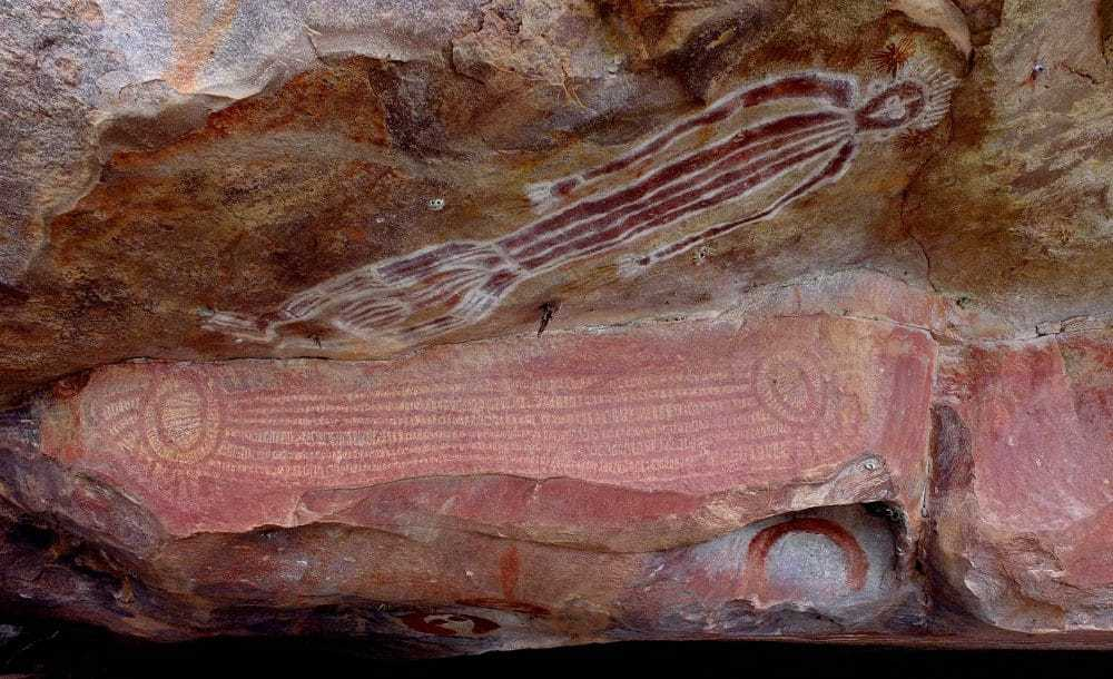 Wanjina rock art painted under an overhanging ledge in The Kimberley.