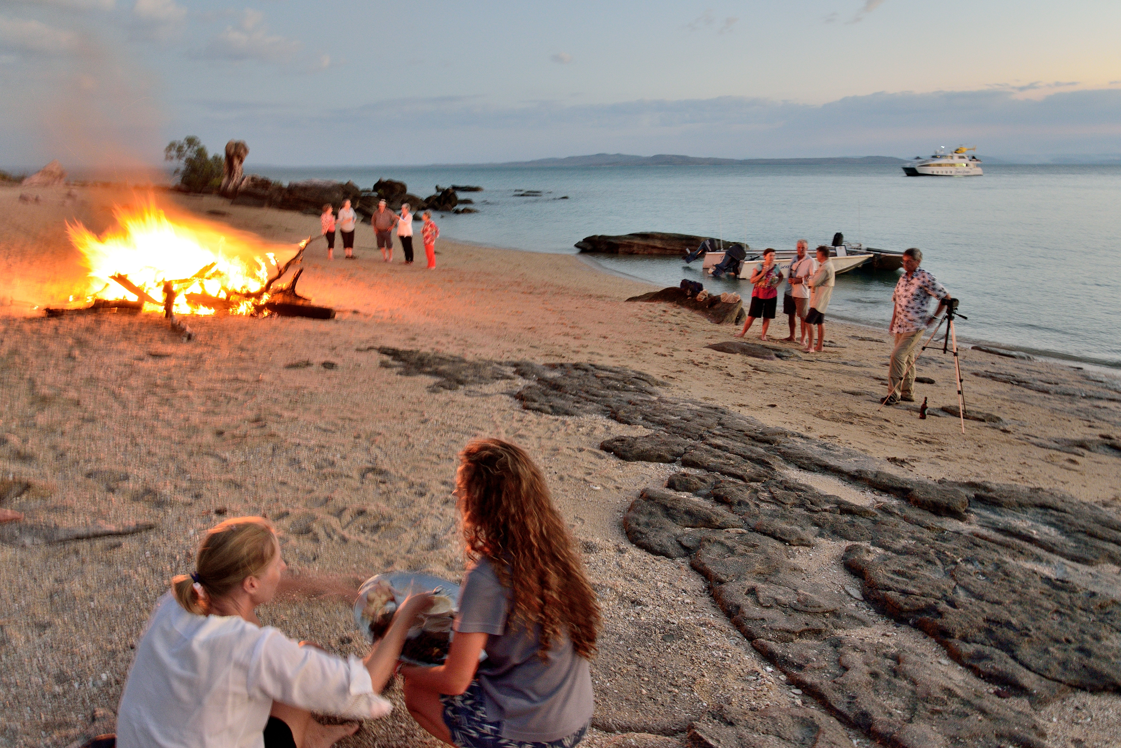 Guests enjoy a pastel-hued sunset barbecue on A Kimberley beach