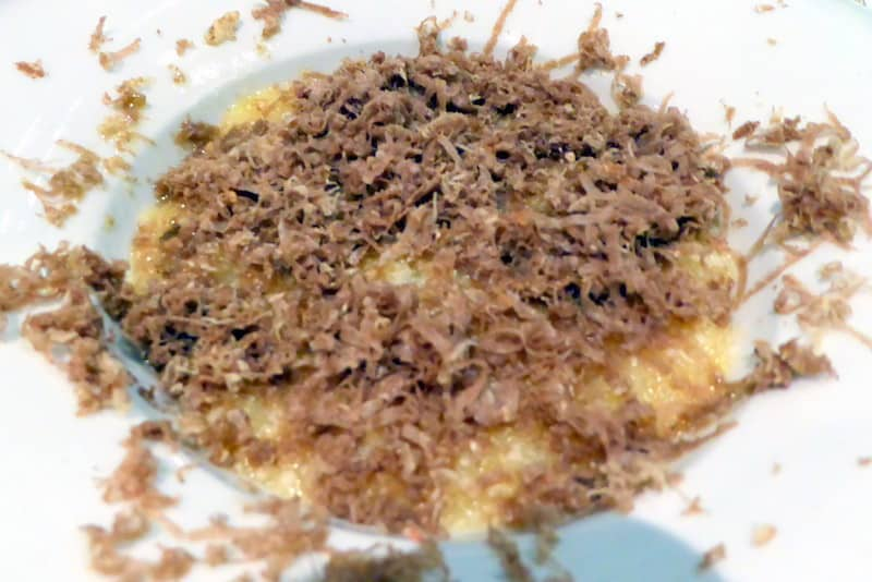 Polenta with extra-virgin olive oil, parmigiano cheese topped with shaved white truffles