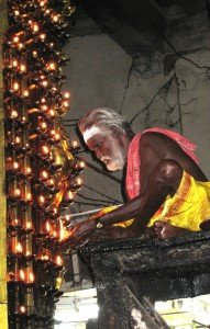 Lighting candles in thetemple is a position of honor in India. Photo by Christine Tibbetts