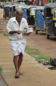 Standard garb for men is the dhoti, worn longor short. Photo by Christine Tibbetts