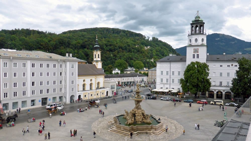 view of the Residenzplatz and horse fountain from the DomQuartier, Salzburg