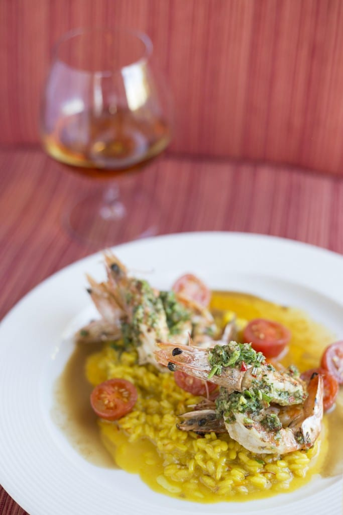 Grilled prawns, saffron risotto, and sauce vierge (Credit: Jason van der Merwe)