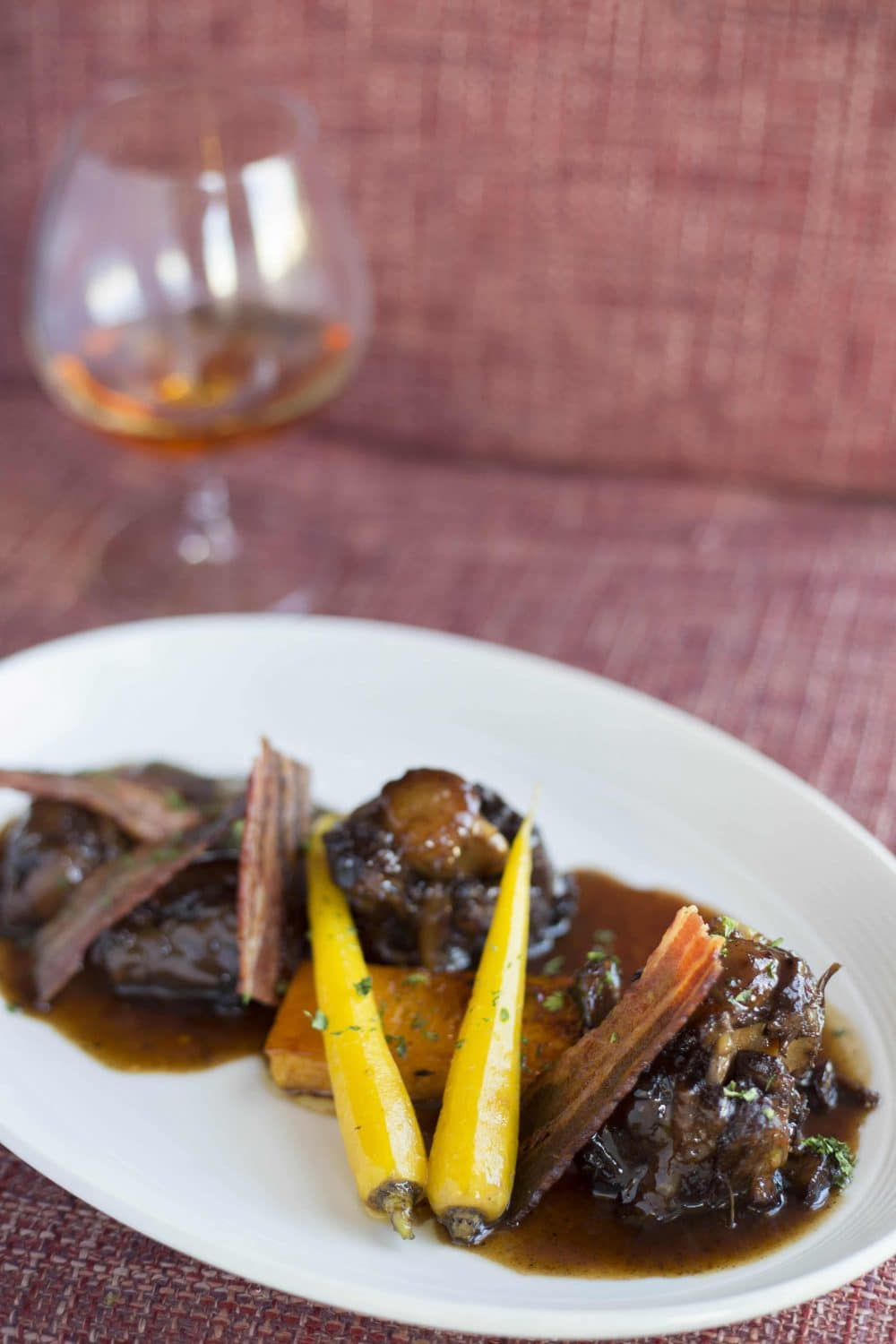 Slow braised beef oxtail, smoked bacon, black mushroom purée, butternut, and parsnips (Credit: Jason van der Merwe)
