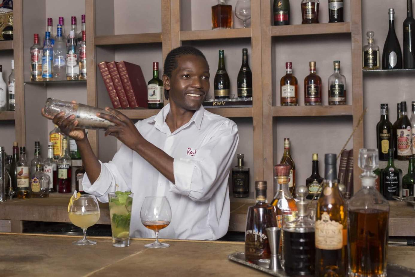 A barman at Abalone House and Spa makes brandy cocktails (Credit: Jason van der Merwe)