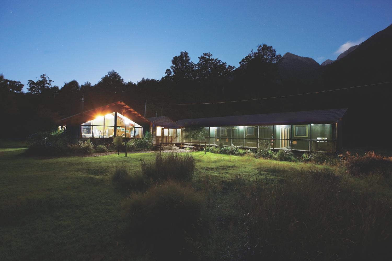 Pyke Lodge at night, Hollyford Track, New Zealand (c) Ngai Tahu Tourism. FWT Magazine.
