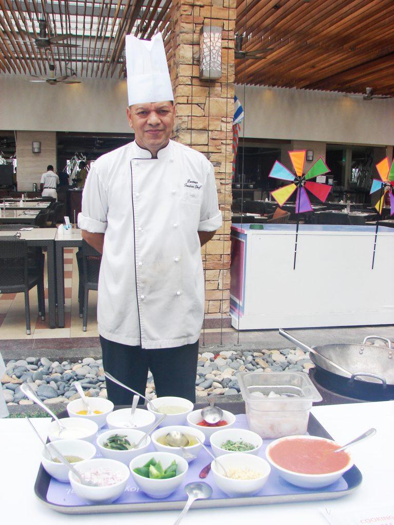 Chef Laxman ready to show the group how to make Jingha Masala (c) Sandra Scott. FWT Magazine.
