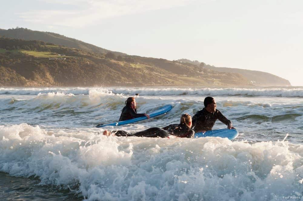 Surfers, Raglan Beach. New Zealand. FWT Magazine