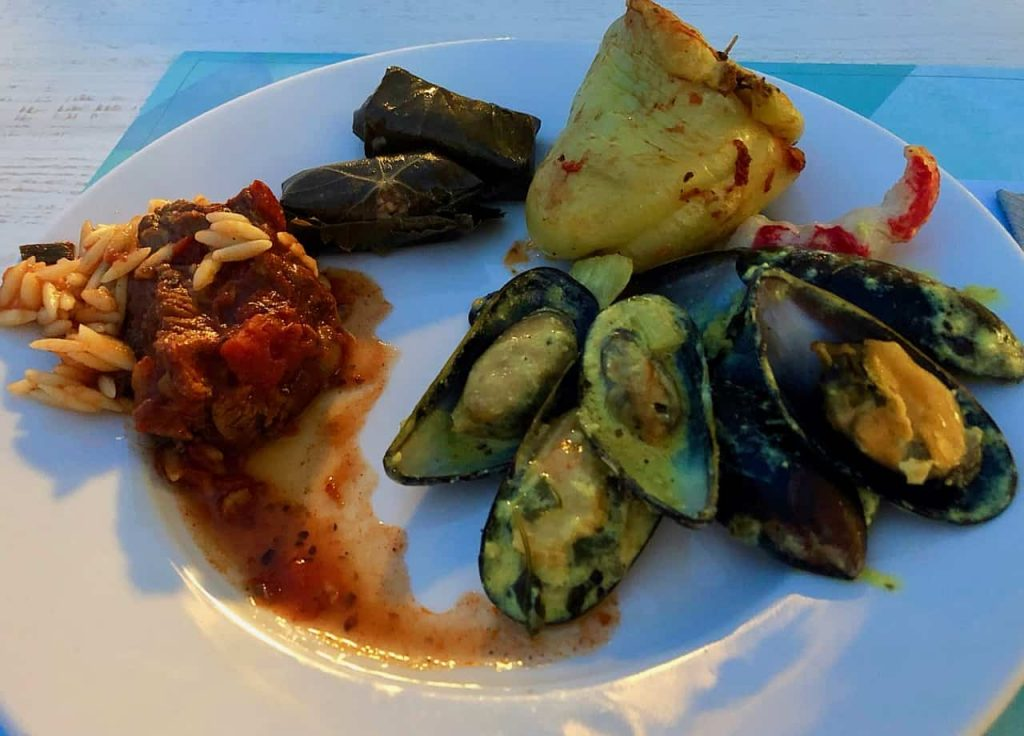 L-R: Youvetsi (beef-rice); Dolmades (stuffed grape leaves); Yemistes (Stuffed Pepper; Lobster slice; and Mussels