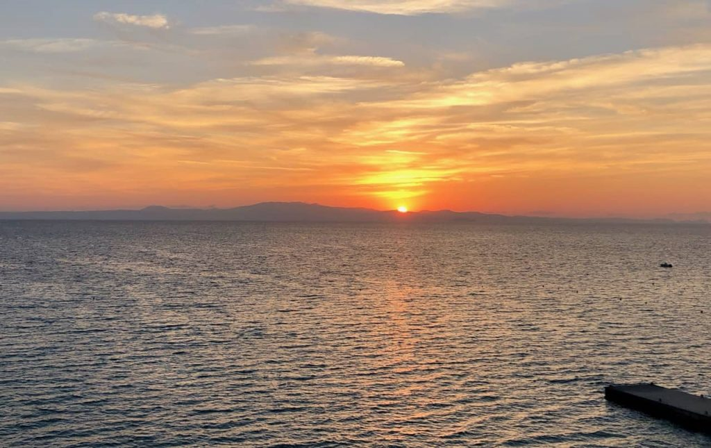 A view of the Aegean at Sunset from the Ammon-Zeus Hotel