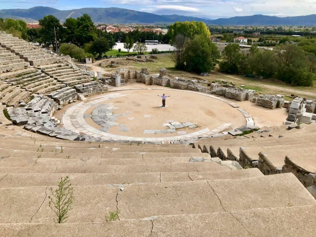 The author standing at the epicenter of the theater at Philippi