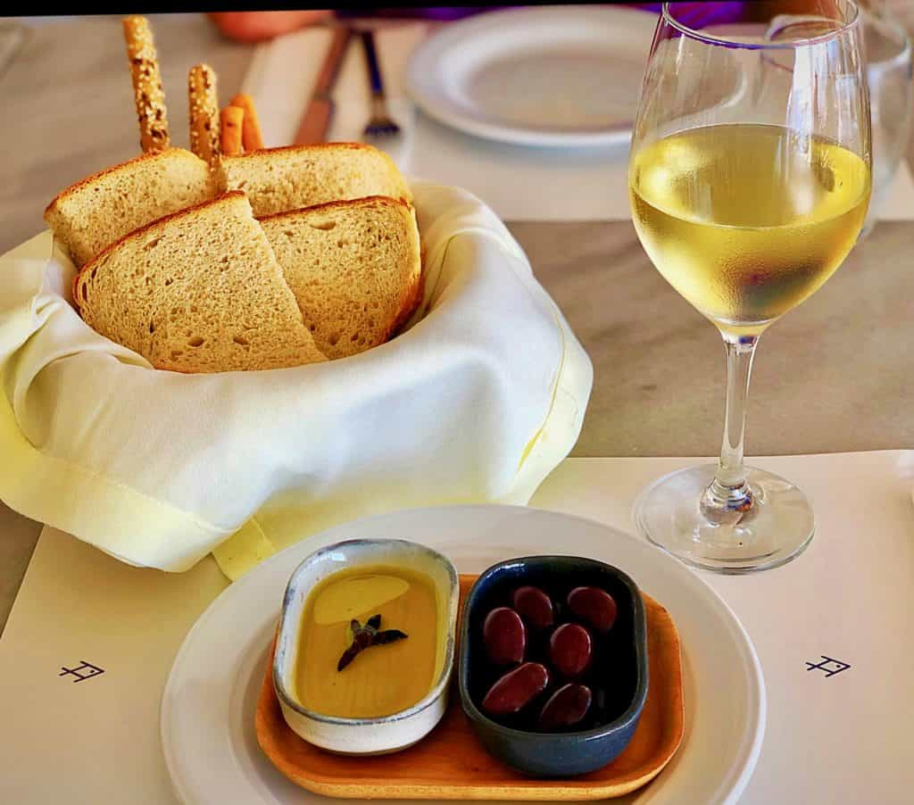 Appetizers with a glass of Thema, a white wine from Drama, Greece
