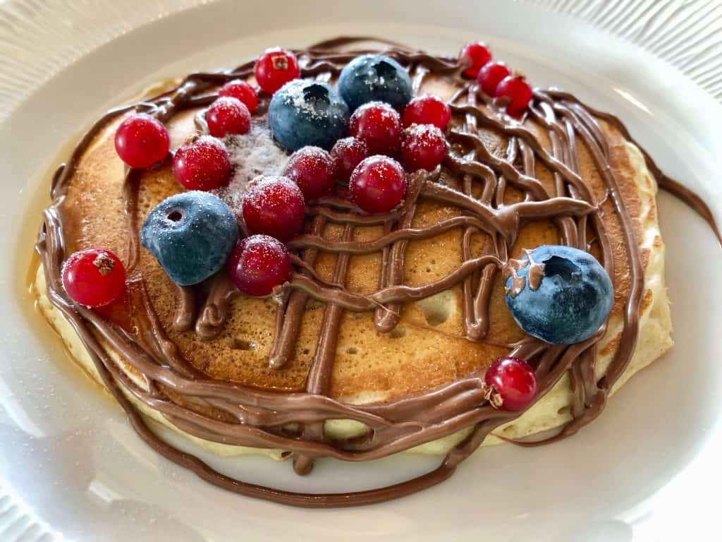 Pancakes with berries at the Lofos restaurant, Eagles Palace Villa, Skala, Greece
