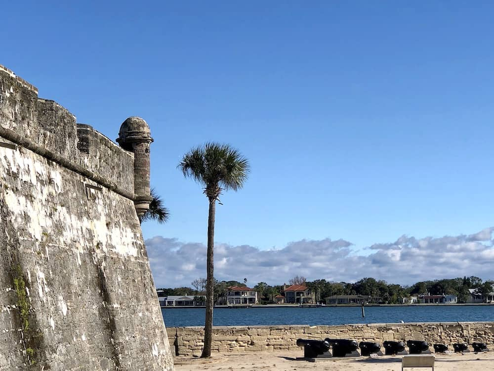 Castillo de San Marcos with palm tree and view of St. Augustine port. ©Priscilla Willis