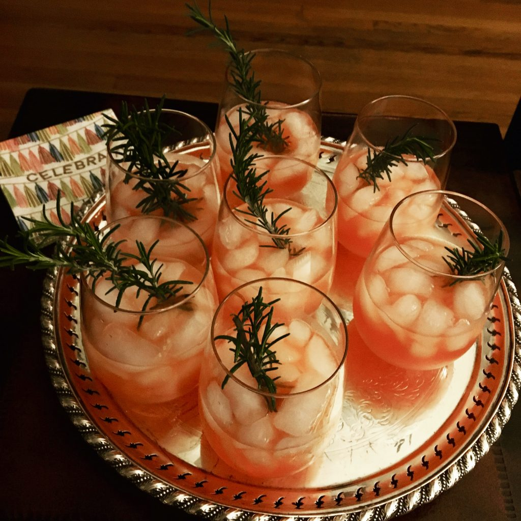 7 cocktails on a silver tray
