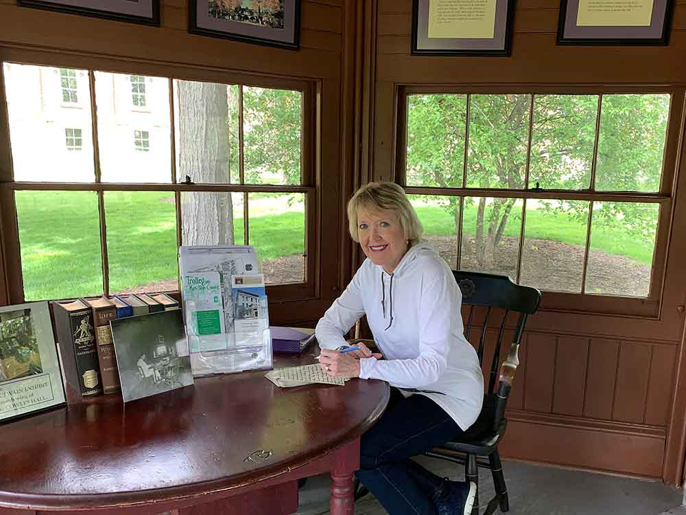 Sitting at Mark Twain's desk