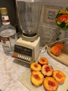 Blender with peaches for Bloomer Droppers drink