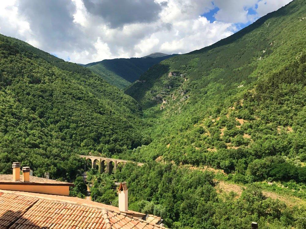 Green hills, valley, aqueduct