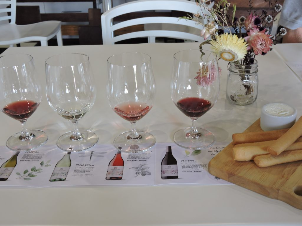 Image of four wine glasses arranged with tastes of wine