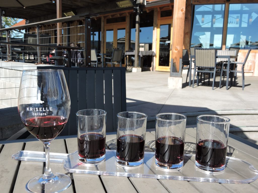 Wine glass and four samples at Kriselle Cellars