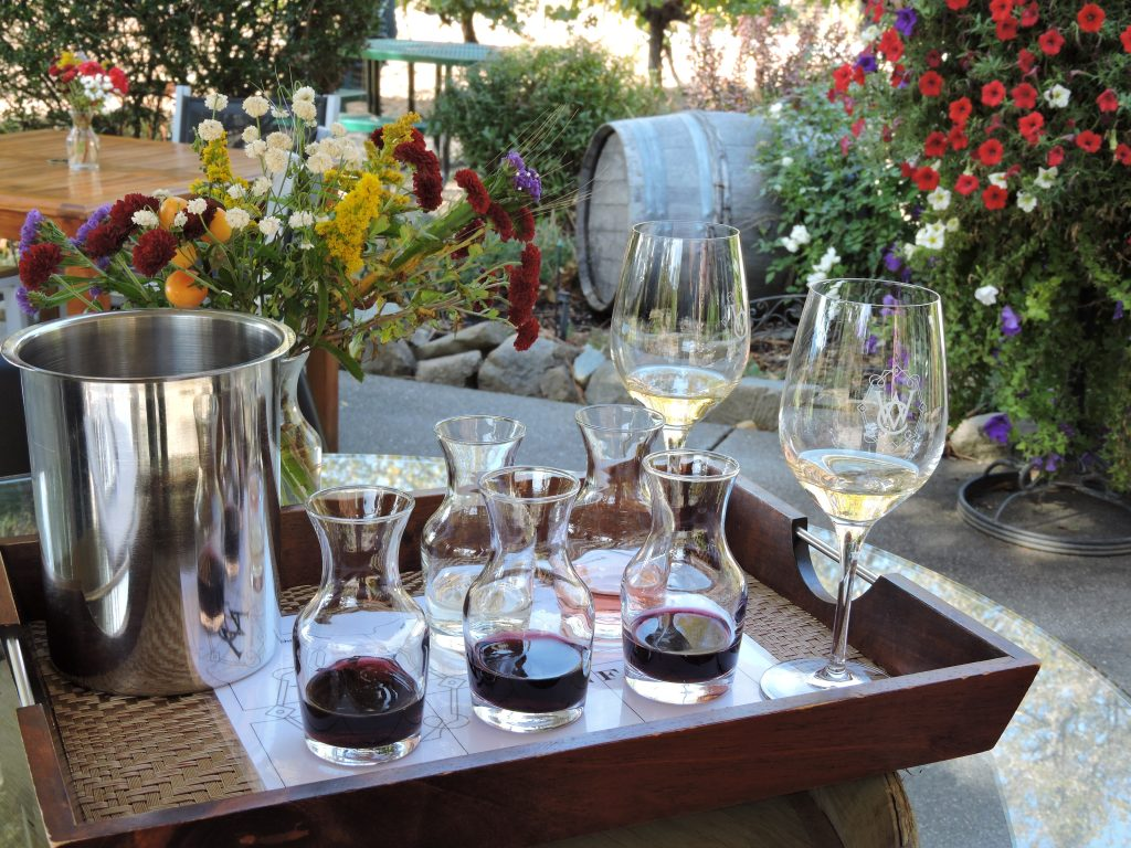 Tray with two wine glasses and wine tasting samples