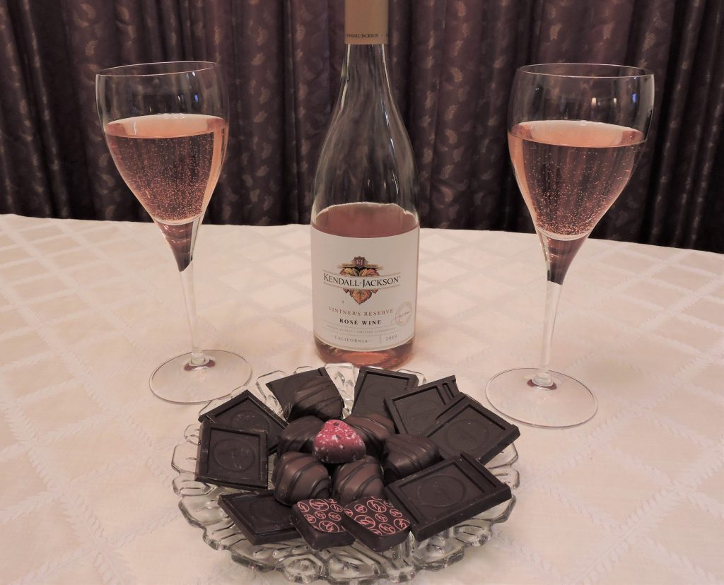 Plate of chocolates and rose wine