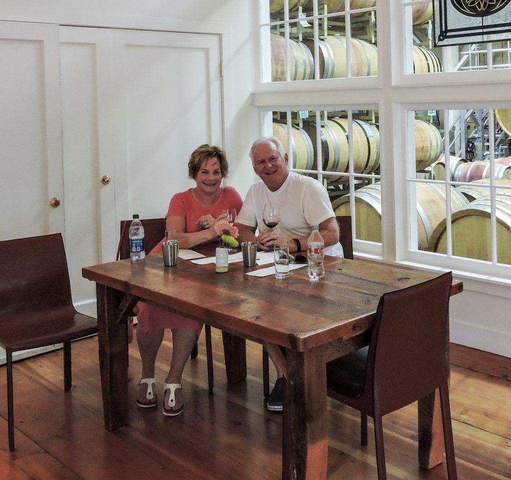 Husband and wife tasting wine